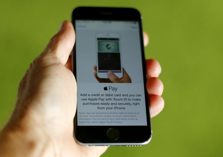 An Apple iphone 6 with Apple Pay is shown in this photo illustration in Encinitas , California June 3, 2015. Interviews with analysts, merchants and others suggest that Apple's forecast may be too optimistic and that many retailers remain skeptical about the payment system.  Photo taken June 3, 2015. To match story APPLE-PAY/     REUTERS/Mike Blake  - RTX1FA2C