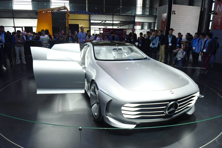 People look at a Mercedes-Benz concept intelligent aerodynamic automobile presented at the CES (Consumer Electronics Show) Asia 2016 in Shanghai, China May 11, 2016. REUTERS/Stringer ATTENTION EDITORS - THIS IMAGE WAS PROVIDED BY A THIRD PARTY. EDITORIAL USE ONLY. CHINA OUT. NO COMMERCIAL OR EDITORIAL SALES IN CHINA.     - RTX2DRY6