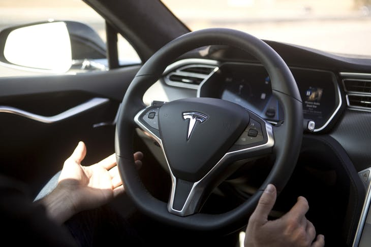 New Autopilot features are demonstrated in a Tesla Model S during a Tesla event in Palo Alto, California October 14, 2015. REUTERS/Beck Diefenbach - RTS4HZ0