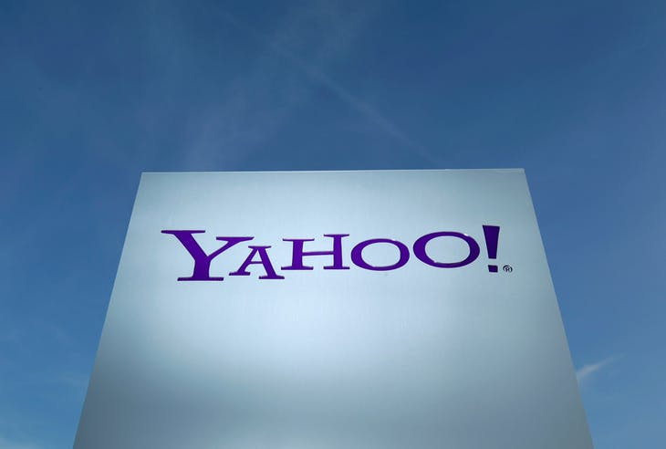 A Yahoo logo is pictured in front of a building in Rolle, east of Geneva, Switzerland December 12, 2012.   REUTERS/Denis Balibouse/File Photo  - RTSP0ST