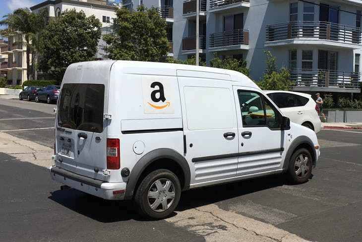 An Amazon.com Inc truck makes deliveries in Los Angeles