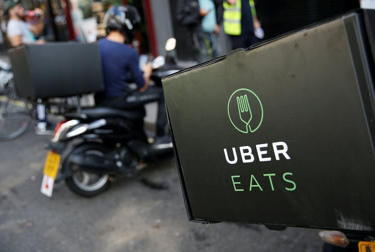 An UberEATS food delivery scooter is seen parked in London, Britain September 7, 2016. Picture taken September 7, 2016. To match FOOD-DELIVERY/  REUTERS/Neil Hall - RTSPOCW
