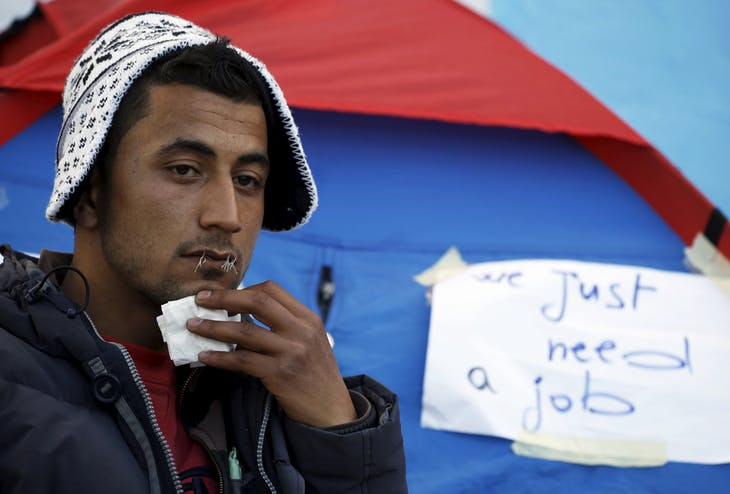 Yosri Adjili, 25, who is unemployed, goes on a hunger strike with his mouth sewed shut during a sit-in protest to get jobs, at the local government office courtyard in Kasserine, Tunisia, January 27, 2016. Young people have been demonstrating for jobs in Kasserine since last week. REUTERS/Zohra Bensemra - RTX249Y0