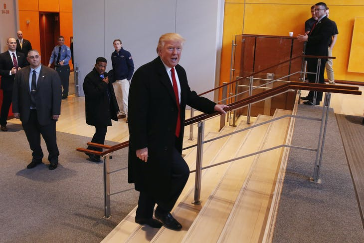 U.S. President elect Donald Trump walks up a staircase to depart the lobby of the New York Times building after a meeting in New York, U.S., November 22, 2016.  REUTERS/Lucas Jackson - RTSSUCX