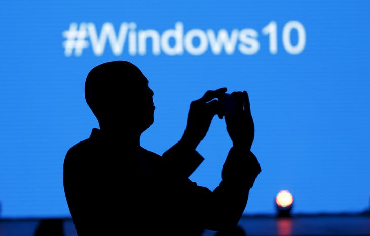 A Microsoft delegate takes a picture during the launch of the Windows 10 operating system in Kenya's capital Nairobi, July 29, 2015. Microsoft REUTERS/Thomas Mukoya - RTX1MBCZ