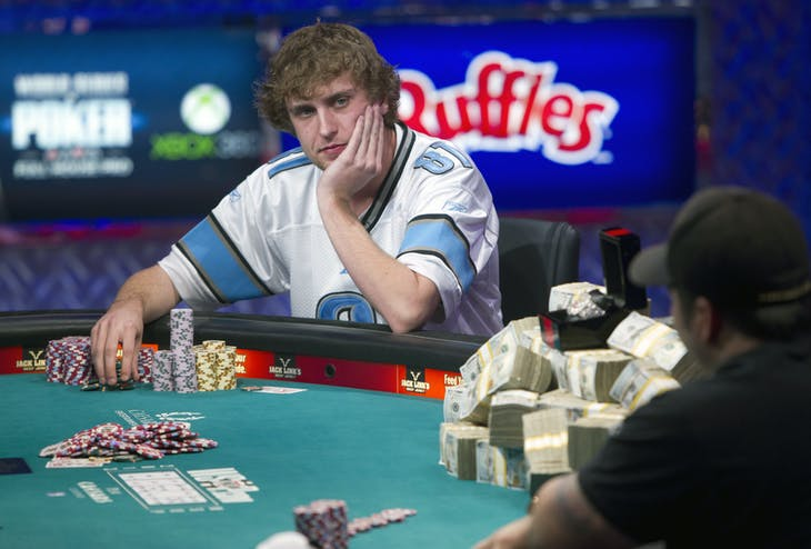 Ryan Riess (L), 23, a poker professional from East Lansing, Michigan contemplates a move against Jay Farber, 29, a Las Vegas VIP Host originally from Santa Barbara, California, during the final table of the World Series of Poker $10,000 buy-in no-limit Texas Hold 'Em tournament at the Rio Hotel & Casino in Las Vegas, Nevada November 5, 2013. REUTERS/Steve Marcus (UNITED STATES - Tags: SOCIETY) - RTX151SF