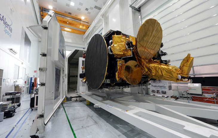 A satellite is seen near a container waiting to be shipped from the Thales Alenia Space plant in Cannes, France, February 3, 2017.   REUTERS/Eric Gaillard - RTX2ZJAN