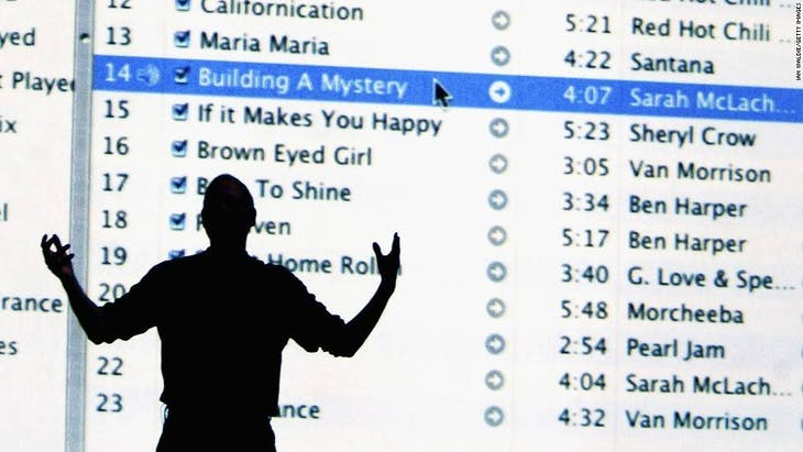 LONDON - JUNE 15:  Steve Jobs, Chief Executive Officer of Apple computers, stands by a projection of the iTunes website as he launches iTunes Music Store in the territories of Great Britain, Germany and France, on June 15, 2004 in London. The iTunes store allows users to buy and download albums or individual songs from a library of 700,000 songs.  (Photo by Ian Waldie/Getty Images) *** Local Caption *** Steve Jobs