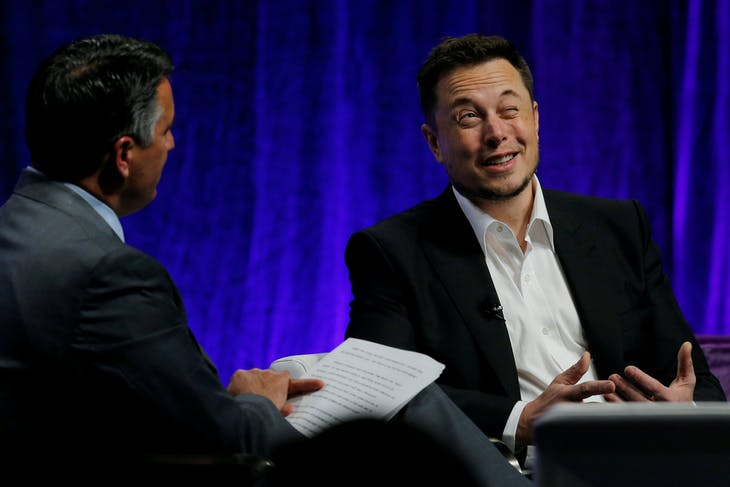 Tesla Motors CEO Elon Musk (R) answers questions from Nevada Governor Brian Sandoval during the National Governors Association Summer Meeting in Providence, Rhode Island, U.S., July 15, 2017. REUTERS/Brian Snyder     TPX IMAGES OF THE DAY - RTX3BLW1