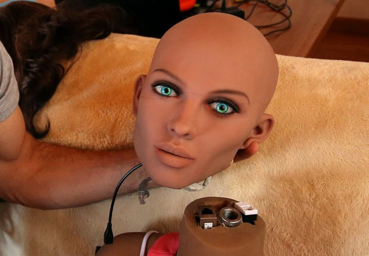 Catalan nanotechnology engineer Sergi Santos holds the head of Samantha, a sex doll packed with artificial intelligence providing her the capability to respond to different scenarios and verbal stimulus, in his house in Rubi, north of Barcelona, Spain, March 31, 2017. Picture taken March 31, 2017. REUTERS/Albert Gea     TPX IMAGES OF THE DAY - RTX3A1V5