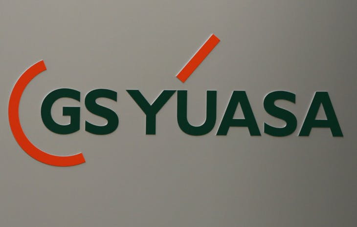 A logo of GS Yuasa Corp. is seen at the cpmpany's Tokyo office in Tokyo January 9, 2013. Shares of Japan's GS Yuasa Corp , which makes batteries for Boeing Co's new 787 Dreamliner, fell sharply for a second day on Wednesday after a fire aboard a Japan Airlines aircraft earlier this week. REUTERS/Issei Kato (JAPAN - Tags: TRANSPORT BUSINESS SCIENCE TECHNOLOGY LOGO) - RTR3C8GI