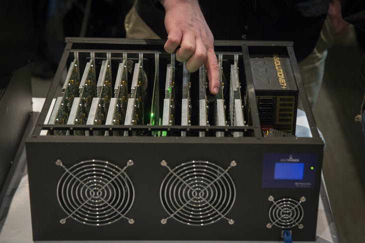 A man explains how a digital currency mining operation works while pointing at the necessary hardware during the Inside Bitcoins: The Future of Virtual Currency Conference in New York April 8, 2014. REUTERS/Lucas Jackson (UNITED STATES - Tags: BUSINESS SCIENCE TECHNOLOGY) - RTR3KH21