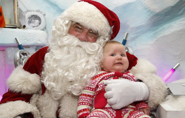 Actor David Warren, who has been playing Santa for the past ten years, holds seven-month-old Olivia Ruch at Santa's Grotto in Selfridges department store in London December 7, 2011. REUTERS/Suzanne Plunkett (BRITAIN - Tags: SOCIETY BUSINESS RELIGION) - LM1E7C714XP01