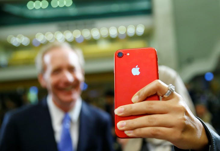 """An attendee takes a selfie with with her iPhone with Brad Smith, President and Chief Legal Officer of Microsoft takes part in a panel discussion """"Cyber, big data and new technologies. Current Internet Governance Challenges: What's Next ?"""" at the United Nations in Geneva, Switzerland November 9, 2017. REUTERS/Denis Balibouse - RC1B1ED220E0"""
