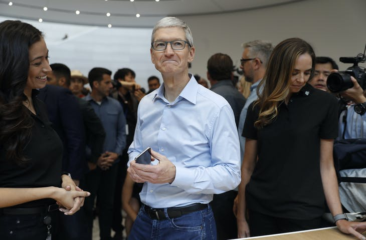 Tim Cook, CEO of Apple, demonstrates an iPhone following a launch event in Cupertino, California, U.S. September 12, 2017. REUTERS/Stephen Lam - HP1ED9C1JO8DM