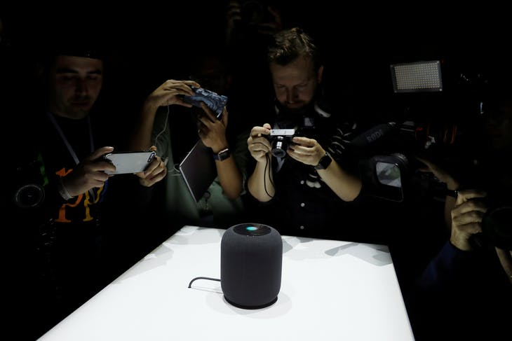 Members of the media photograph a prototype Apple HomePod during the annual Apple Worldwide Developer Conference (WWDC) in San Jose, California, U.S. June 5, 2017. REUTERS/Stephen Lam         TPX IMAGES OF THE DAY - RC164AC0AE30
