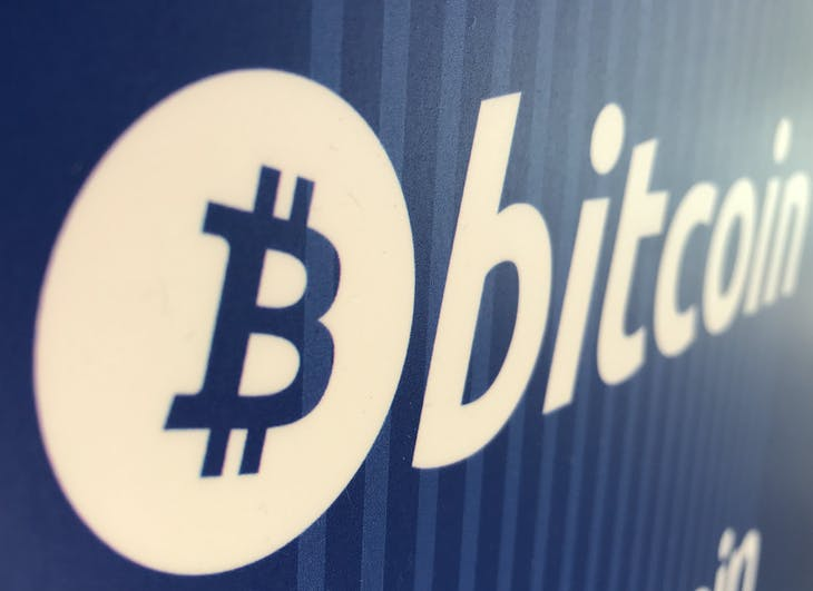 A Bitcoin logo is seen on a cryptocurrency ATM in Santa Monica, California, U.S., January 4, 2018. REUTERS/Lucy Nicholson - RC1757DEA310