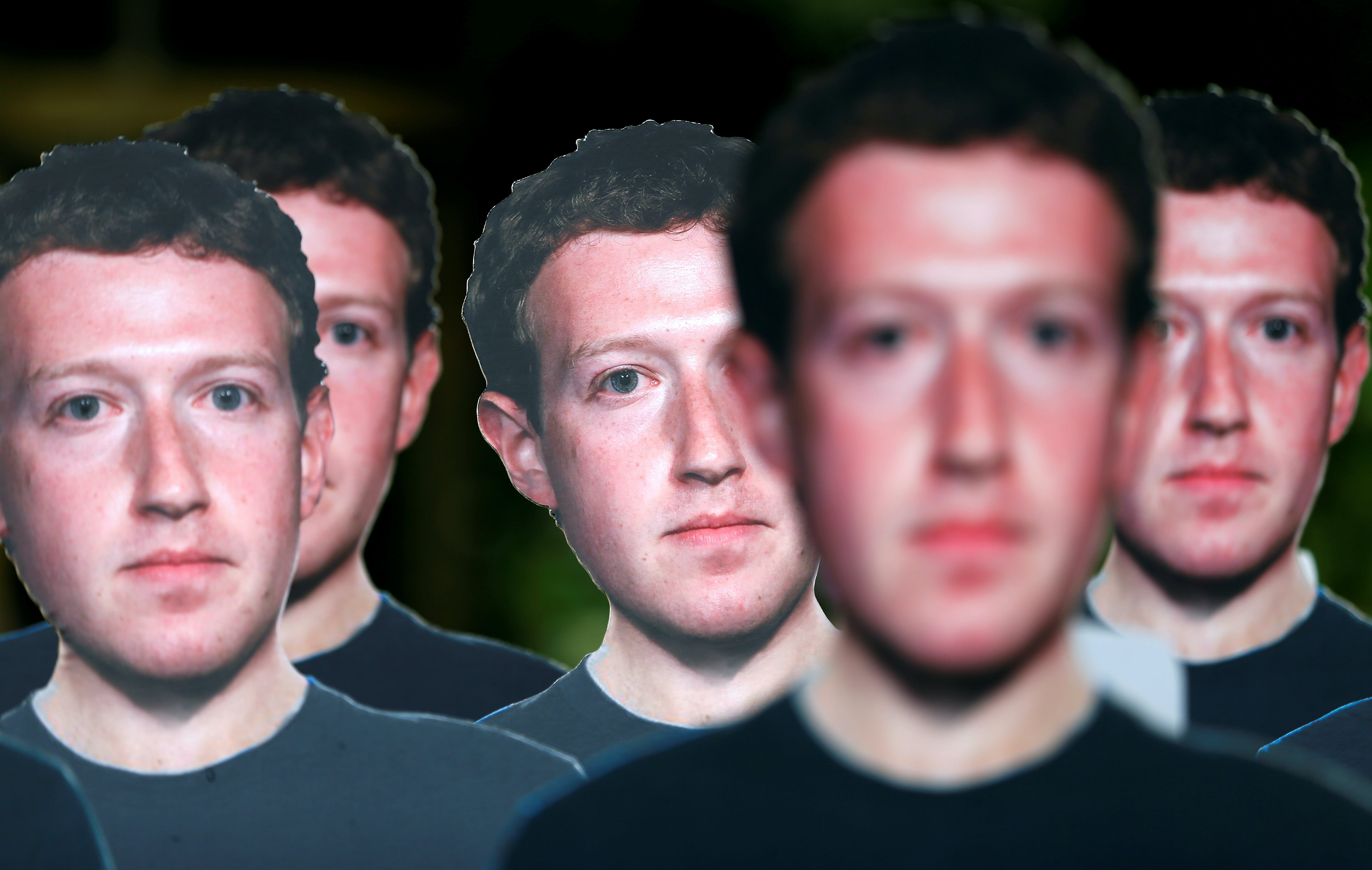 Cardboard cutouts depicting Facebook CEO Mark Zuckerberg are pictured during a demonstration ahead of a meeting between Zuckerberg and leaders of the European Parliament in Brussels, Belgium May 22, 2018. REUTERS/Francois Lenoir     TPX IMAGES OF THE DAY - RC128CC39F90